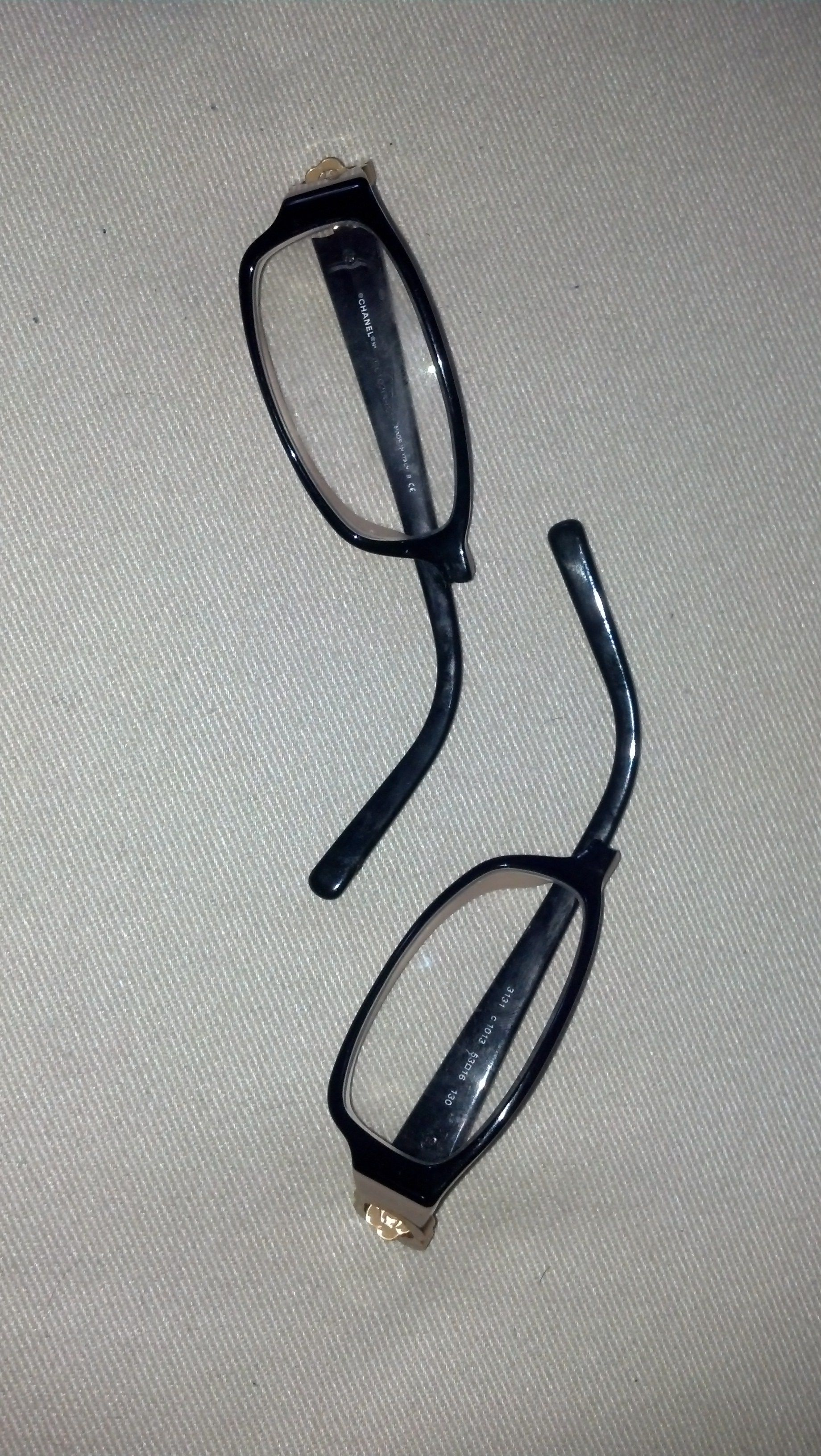 Before photo of plastic Chanel eyeglass frames with broken bridge ...