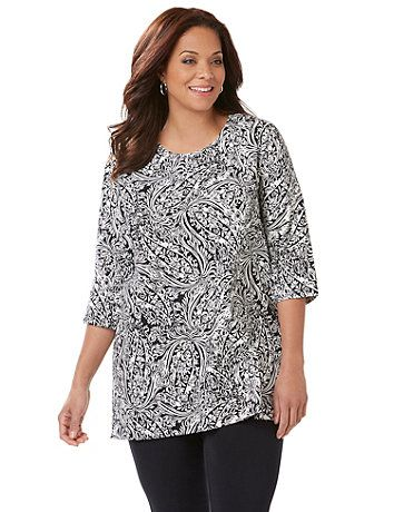 Our extra-long Easy Fit Tees offer relaxed comfort and laid-back style. An allover flourish pattern adds elegance to this soft tee. Designed to dress up or down, it's available in colors that work perfectly into your wardrobe. Scoop neckline. Three-quarter sleeves. catherines.com