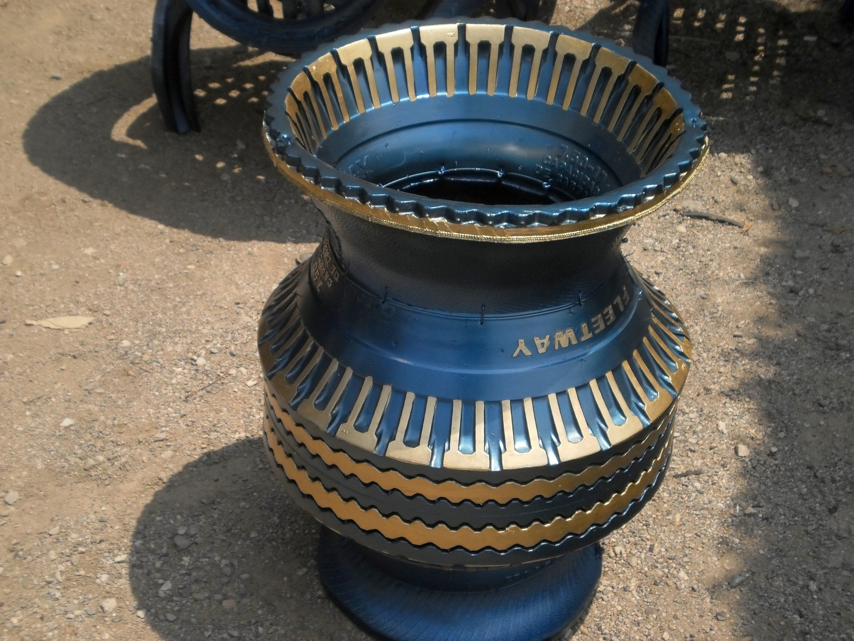 Como reciclar llantas usadas en macetas jarrones grandes for Jarrones decorativos grandes