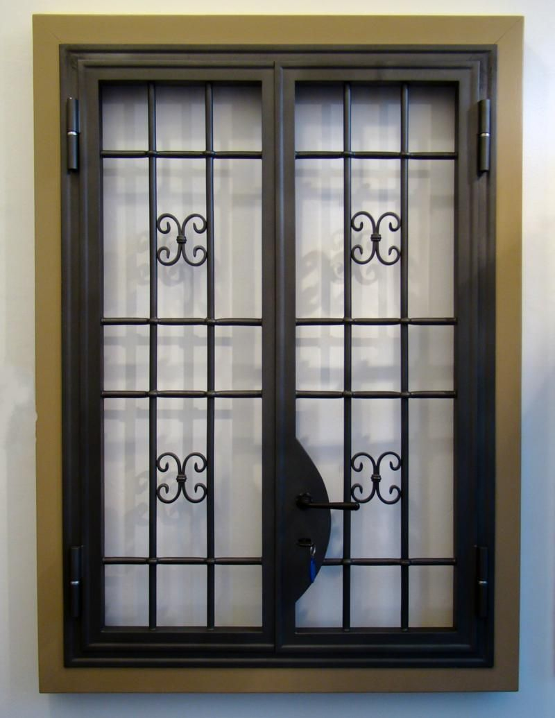 Wrought iron window grilles with cast iron ornaments for Window door design