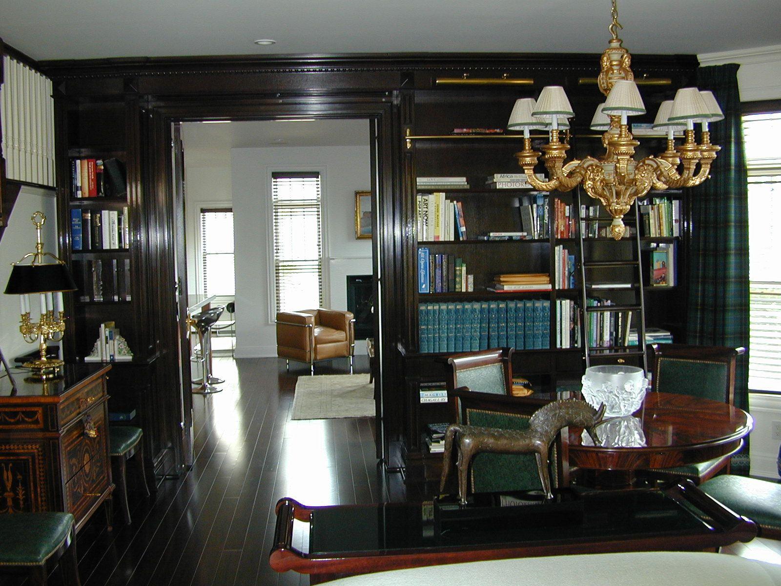 Very dark built in book case with sliding ladder home ideas in