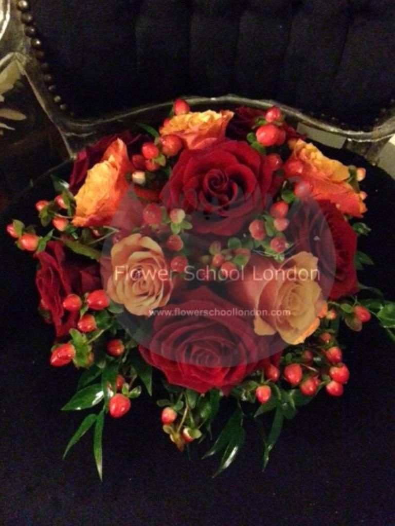 Cherry brandy and Grand Prix roses with hypericum.