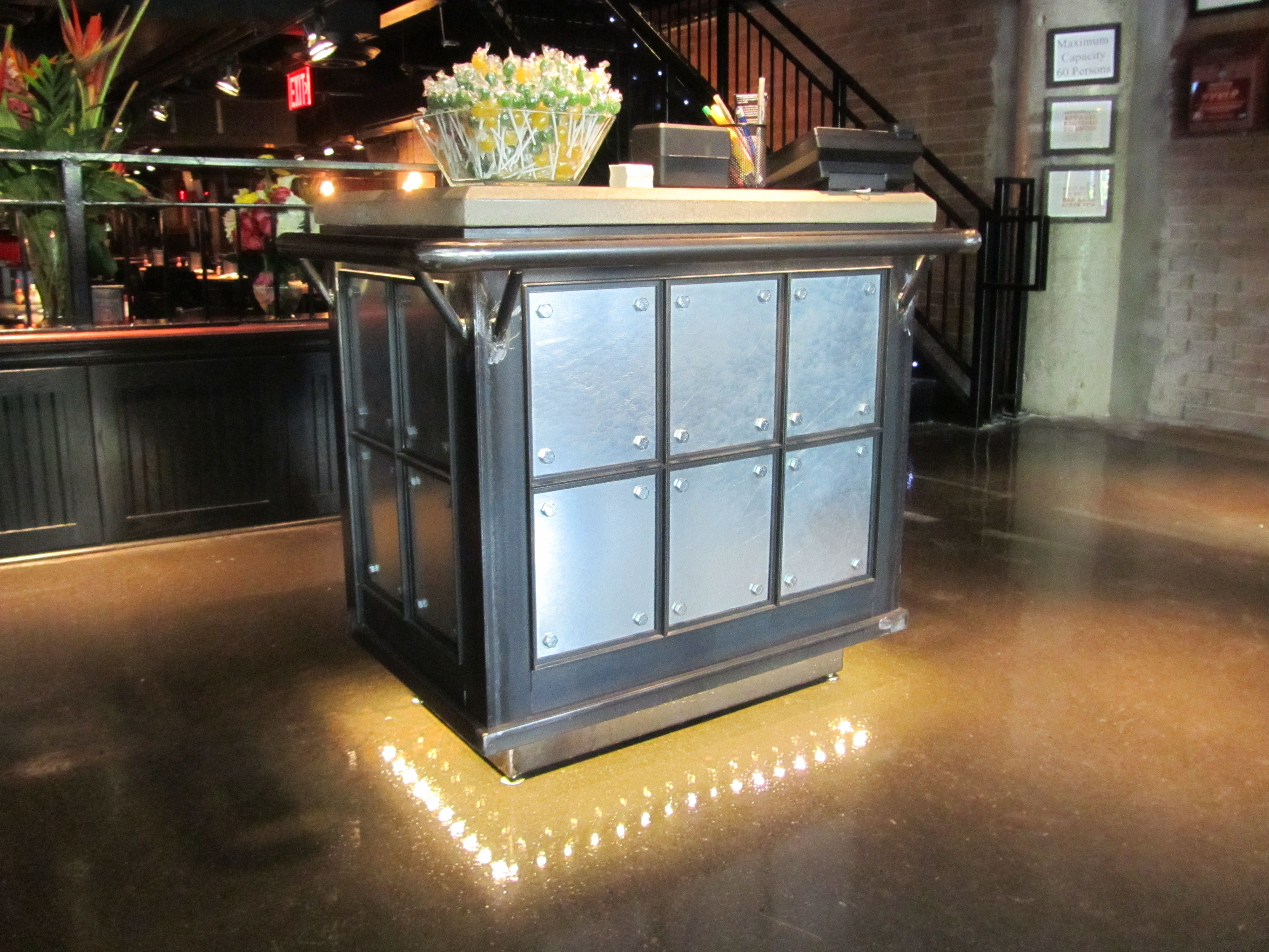 Hostess stand kiosk raw steel base with concrete top and