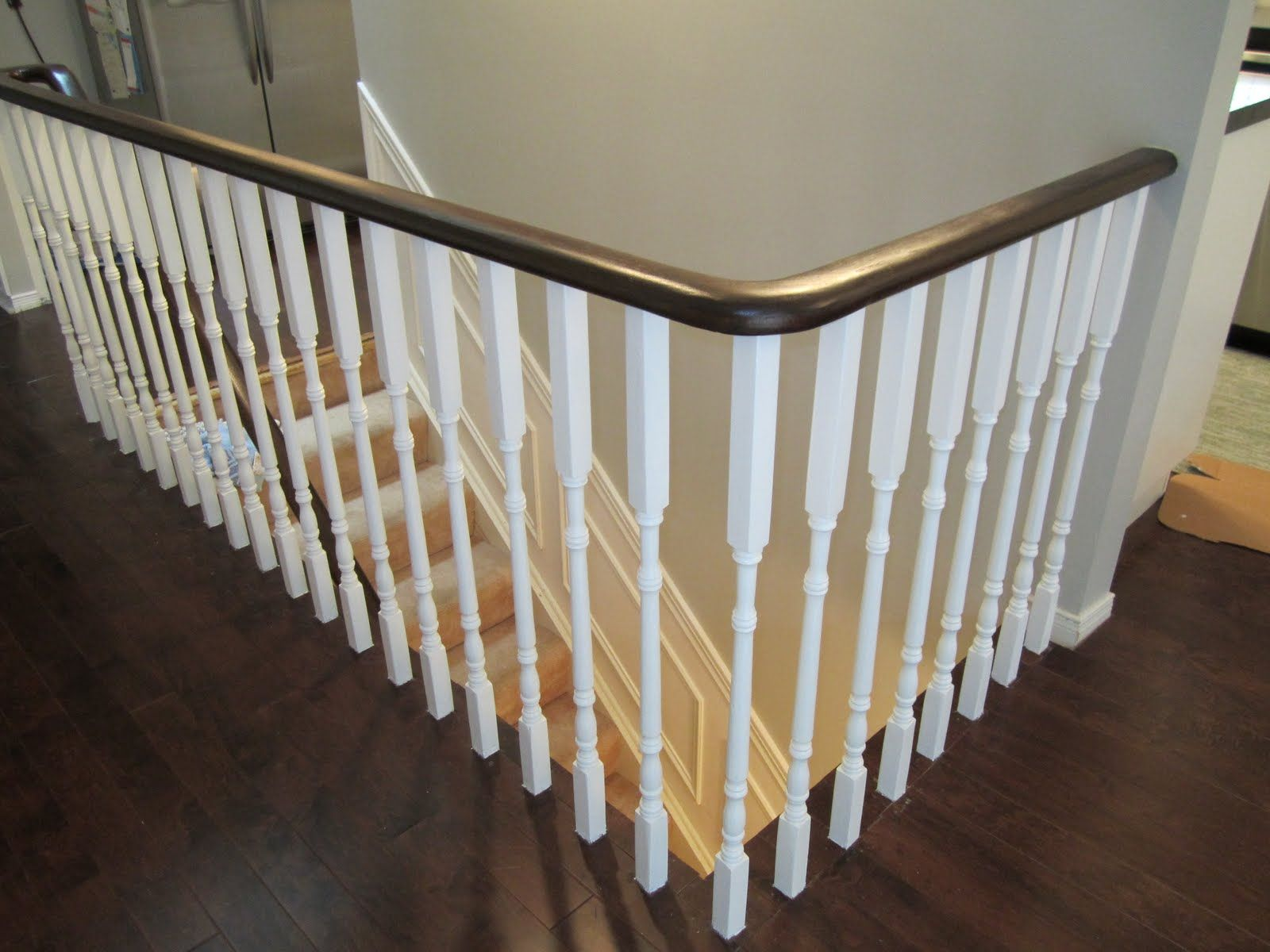 See how updating an oak stair or handrail could look with walnut stain and white rails