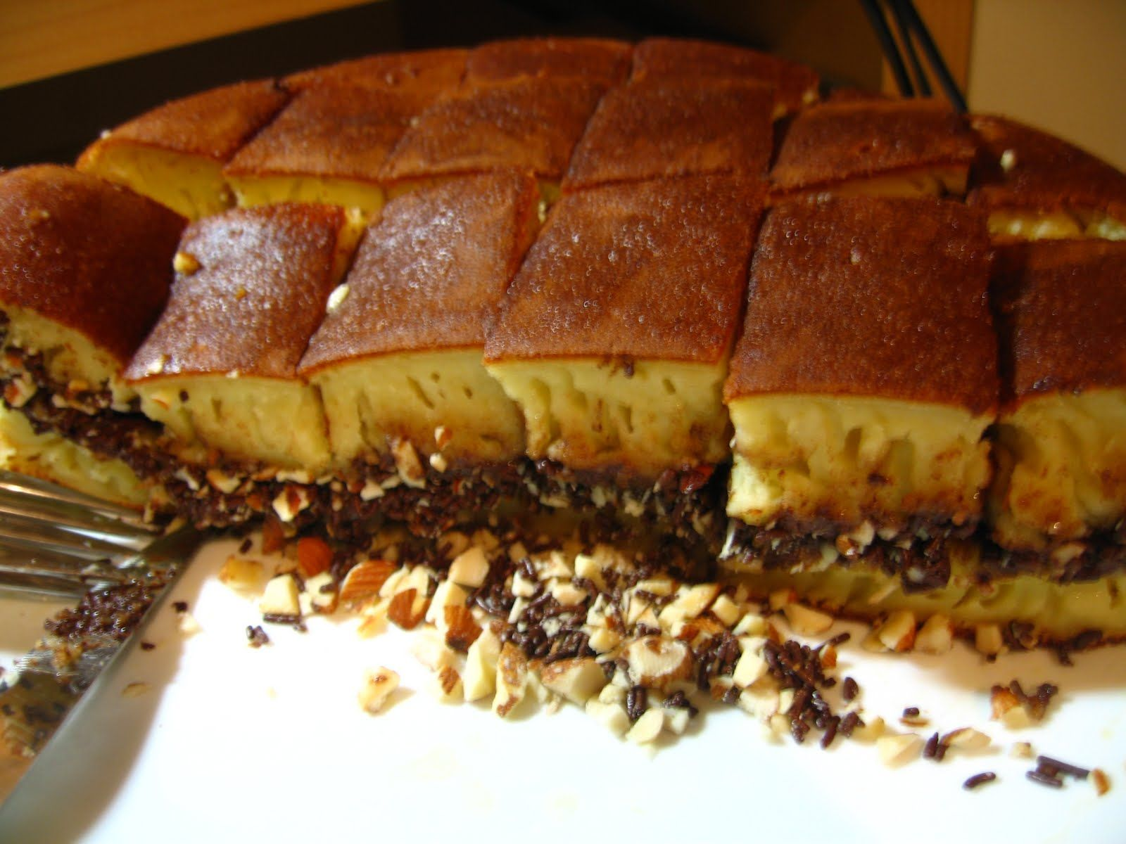Martabak Manis    if you put very thick buttery pancakes with chocolate and peanuts or/and cheese (or any other thing you like to add inbetween).     You can call it Cardiac Arrest in your mouth straight from Indonesia.