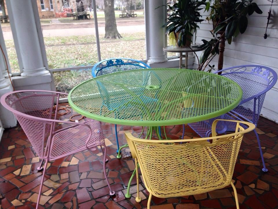 Spray painted wrought iron patio furniture using Rustoleum satin