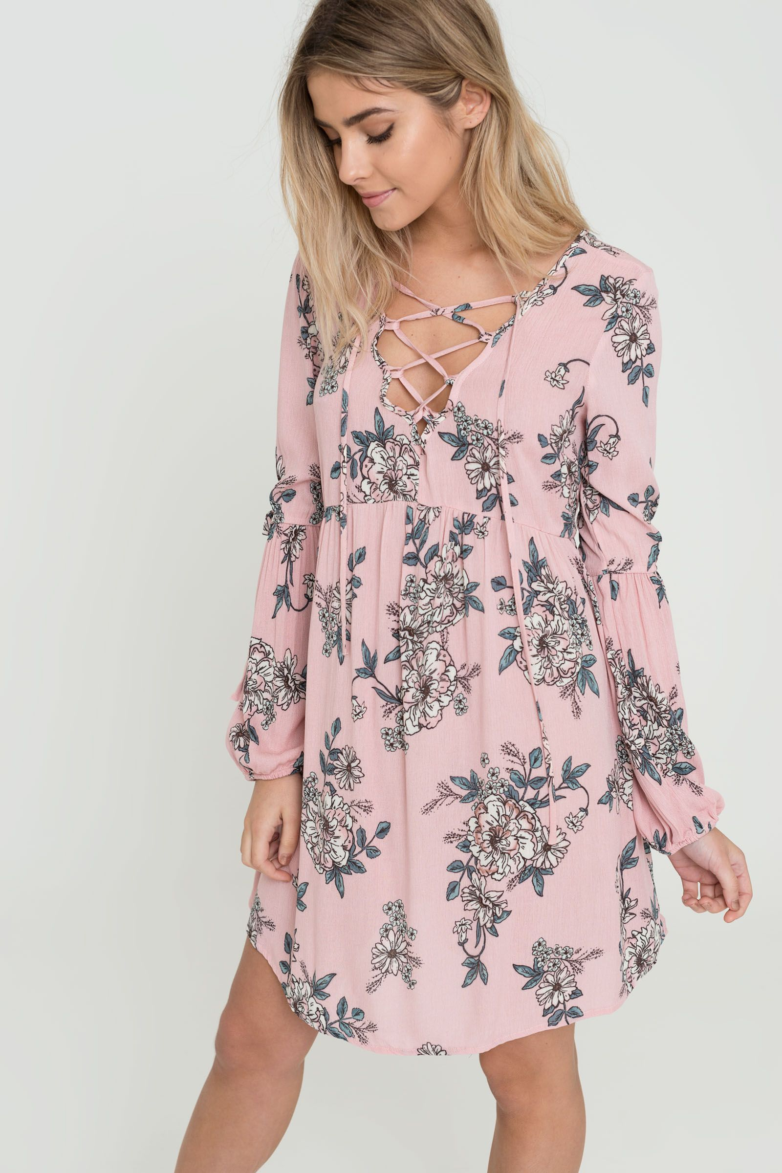 d97e6385aa0412 Airy semi-sheer mini dress. Crepe weave. Deep laced V-neck. Empire ...