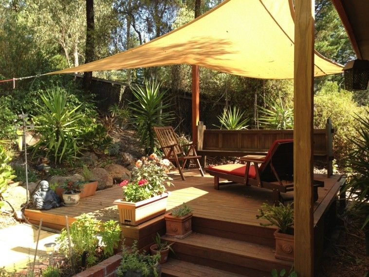 Yellow Sail Cloth Patio Shade With Garden Shade Having With Wooden Sofa And  Chair Over Wooden