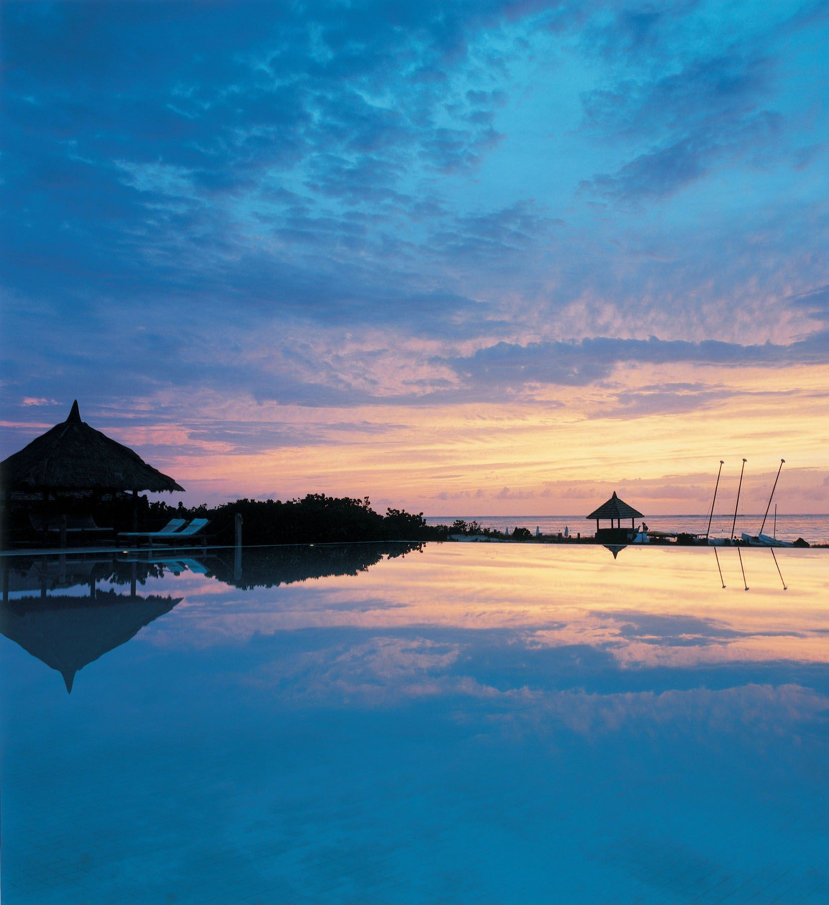 Relax and re-energise on a Parrot Cay Yoga and Pilates Retreat with awe-inspiring evening views like this