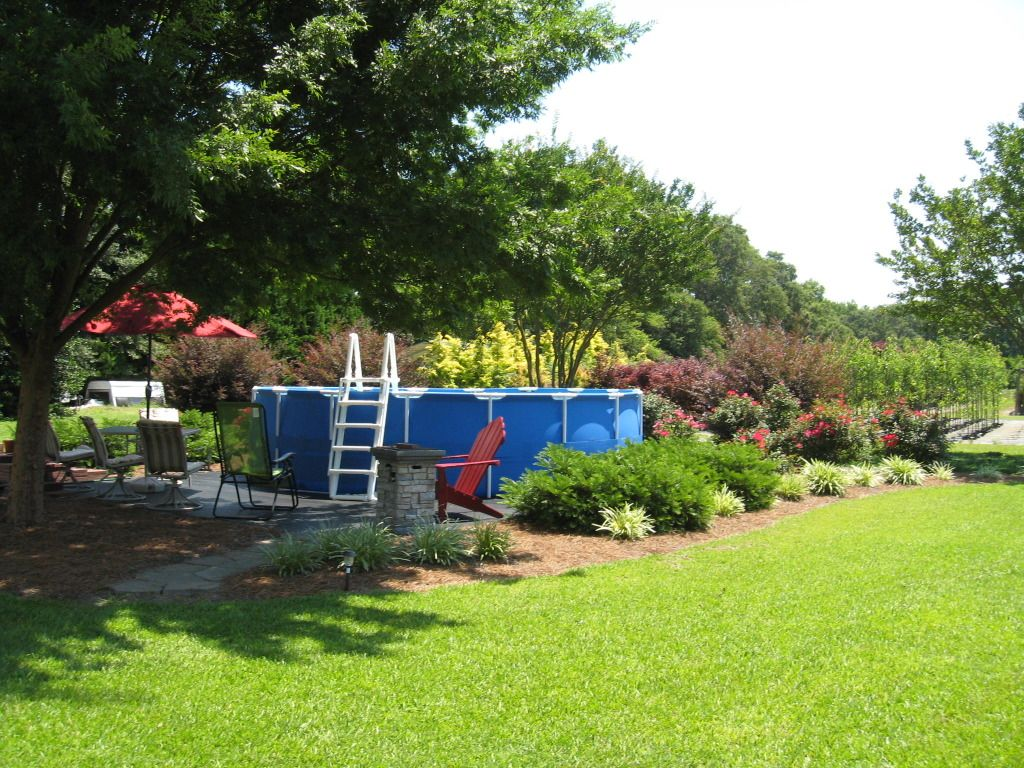 Landscaping around base of intex ultra frame pools above - Above ground swimming pool removal ...
