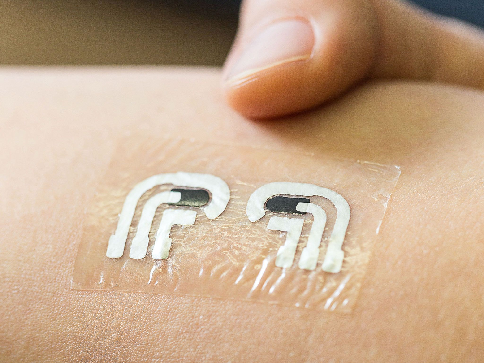 Temporary tattoo measures blood glucose levels Blood