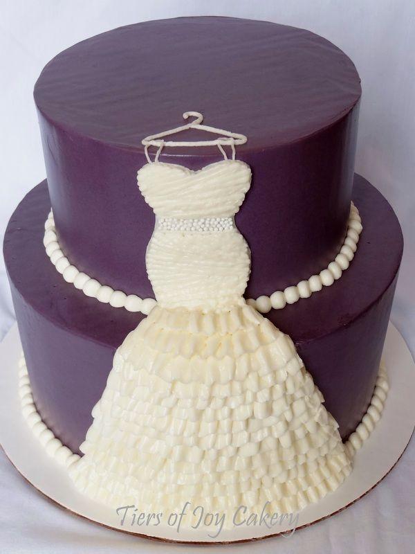 purple bridal shower cake with ruffled buttercream wedding dress