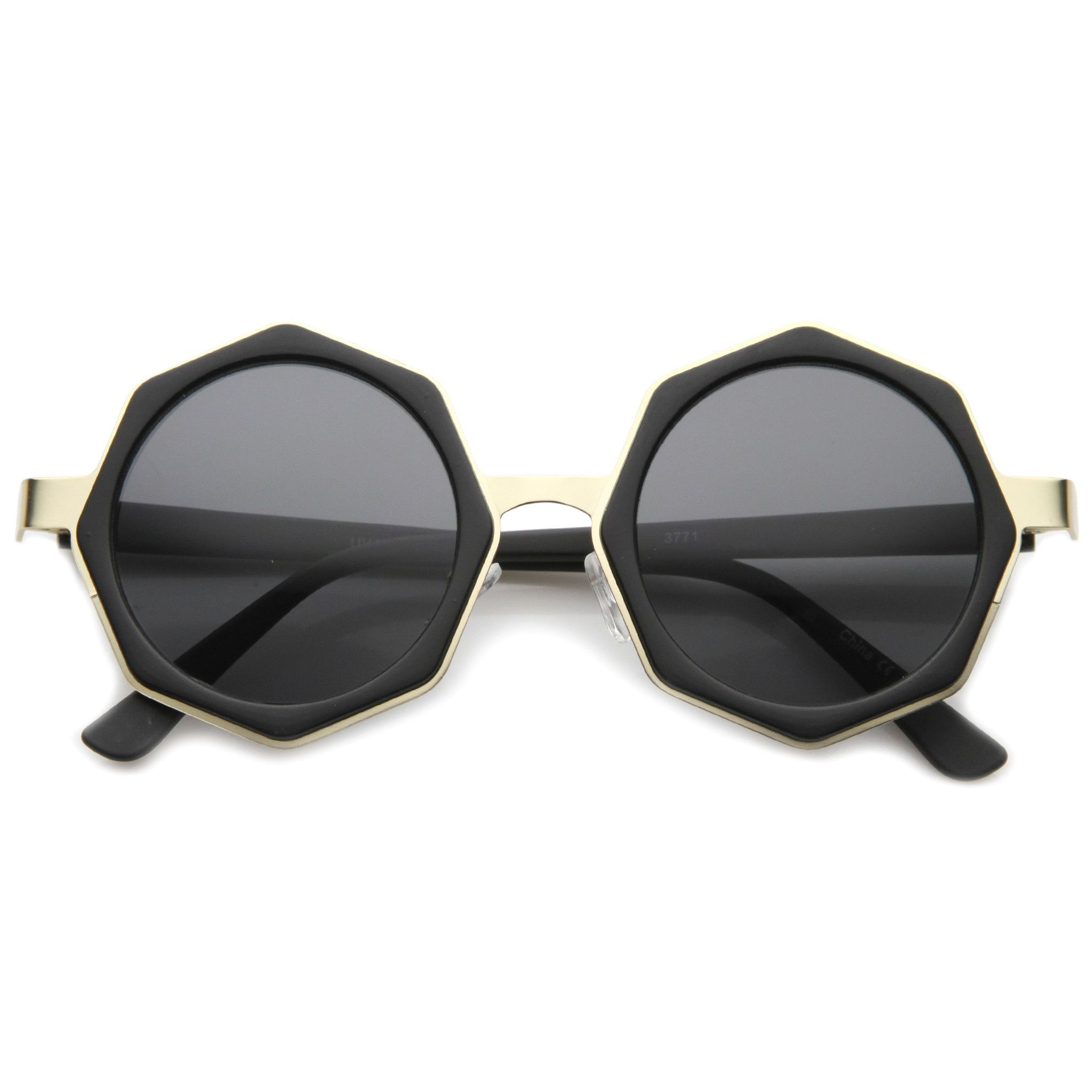 ead79546e ... away from the traditional square and circle frames with these stunning  shades featuring an octagon-shaped design and neutral-hued round flat  lenses. Fin