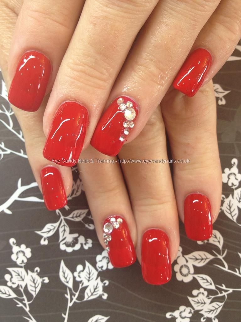 Red polish with Swarovski crystal ring finger over acrylic nails ...