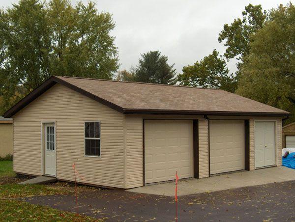 Detached garage 24x32x8 vinyl siding shingle roof 12 for Building a detached garage on a slope
