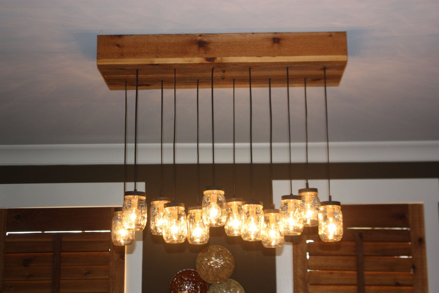 Mason jar chandelier with cedar base 30000 via etsy like this mason jar chandelier with cedar base 30000 via etsy like this look aloadofball Gallery