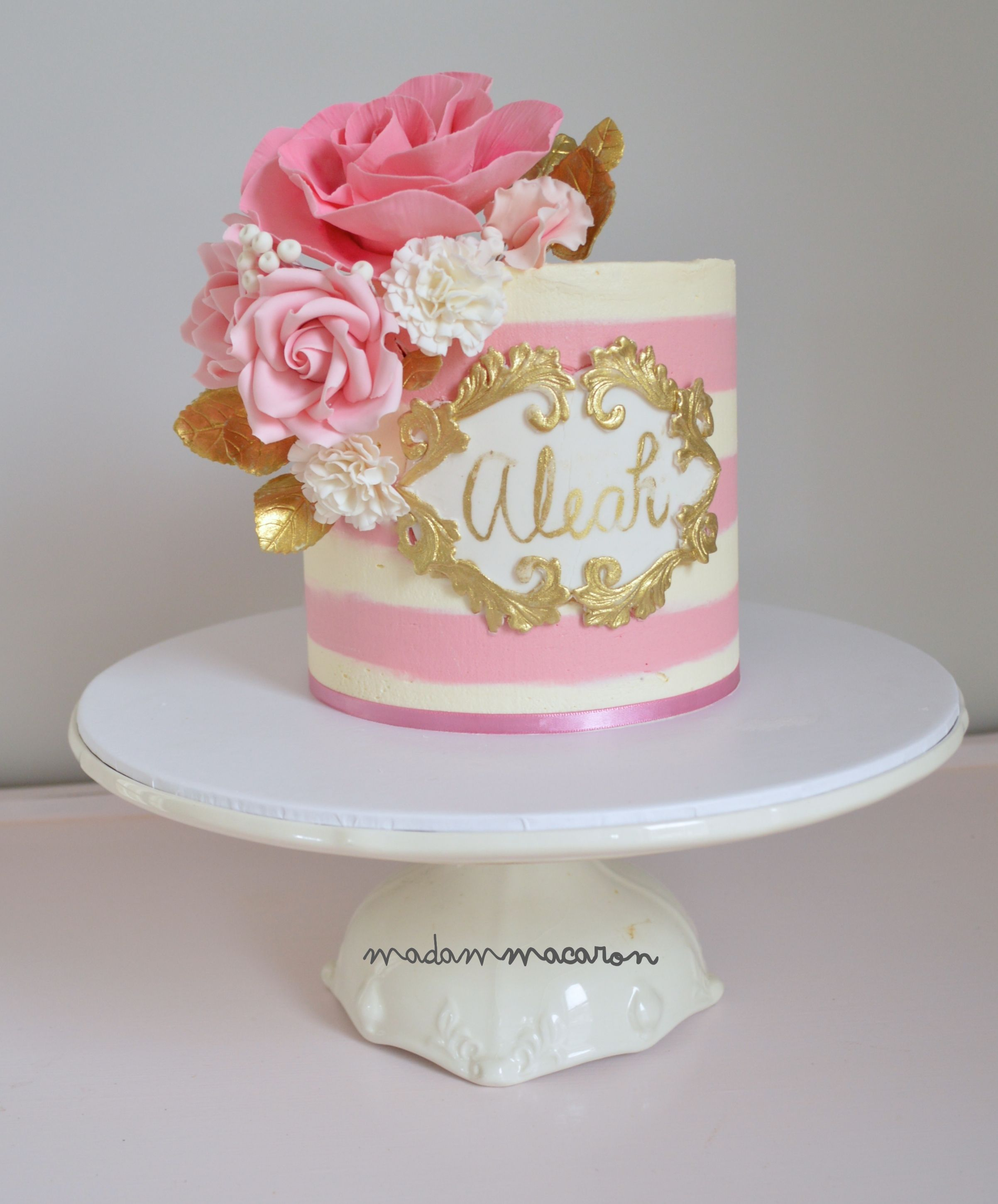 White And Pink Buttercream Striped Cake With A Hand Painted Name Plaque Gold Sugar Flowers