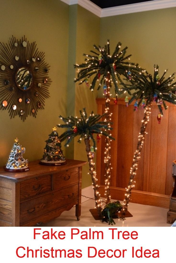 fake palm tree with holiday lights and decorated like a christmas tree christmas decor idea