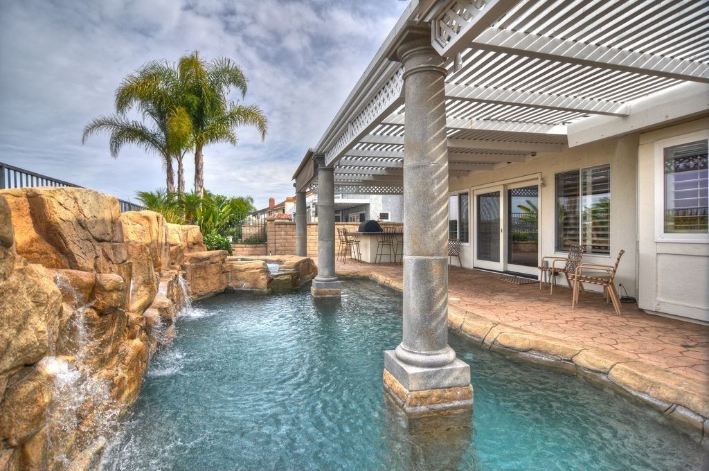 Eclectic Swimming Pool with Trellis, Water feature, Natural rock pool accent, Covered patio, Waterfall feature