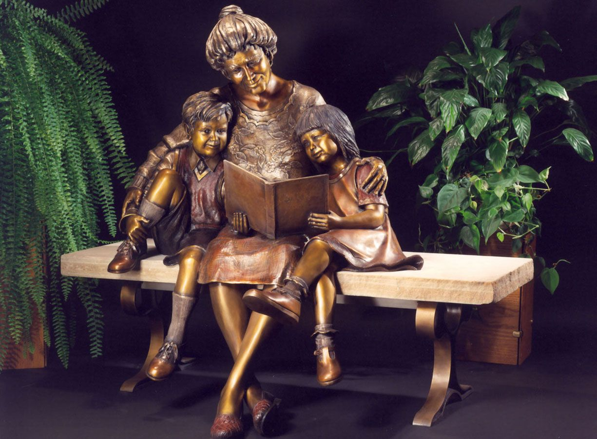 """""""The Good Book"""" sculpture by Mark Lundeen - photo by Lundeen Sculpture; life-size sculpture; Inside the book is a relief of Noah's Ark with the animals coming two by two."""