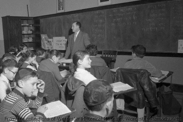 Class in session at Beth Israel Synagogue, April 1957, Worcester Massachusetts. Photograph by Sid Plotkin.  Want a copy of this photo?  >Visit our rights and reproductions page for more information.    #Worcester #WorcesterMA #WorcesterHistory #History #NewEngland #AmericanHistory #JewishHistory #JewishLife #Hebrew #Synagogue #1950s #Children