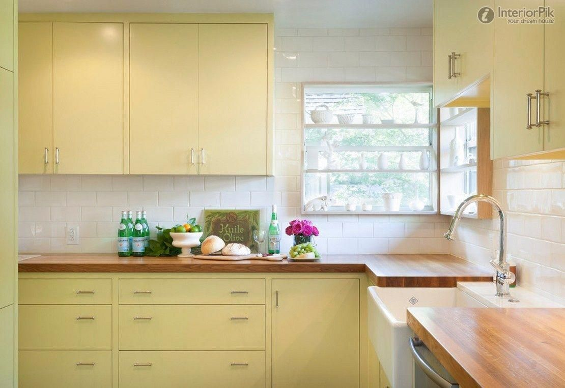 Butter Yellow Cabinets Make A Small L Shaped Kitchen Feel Cheerful And Sunny Shiny Su Yellow Kitchen Cabinets Kitchen Design Small Kitchen Design Modern Small