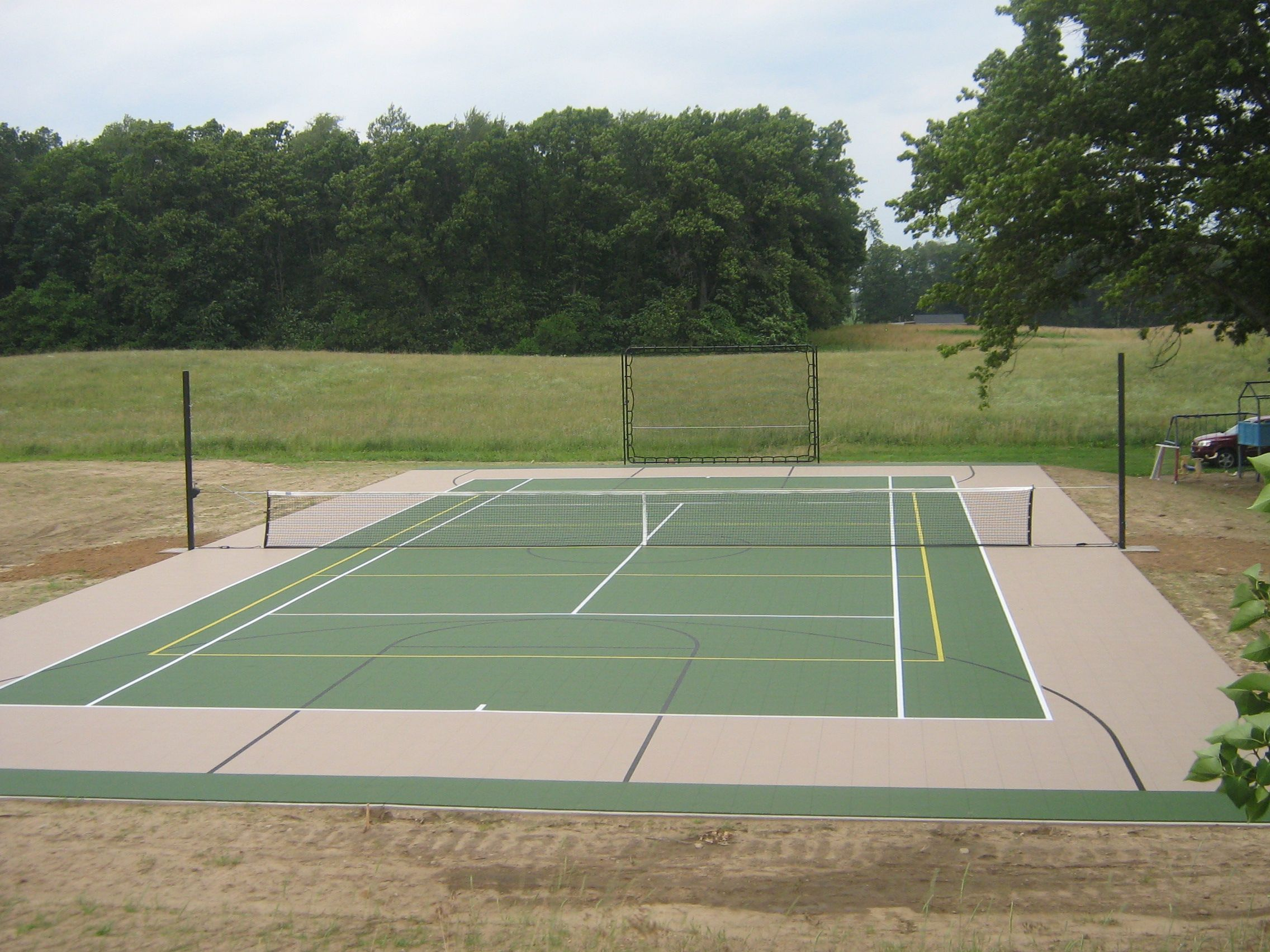 Tennis Court With Multi Sport Poles For Volleyball Tennis