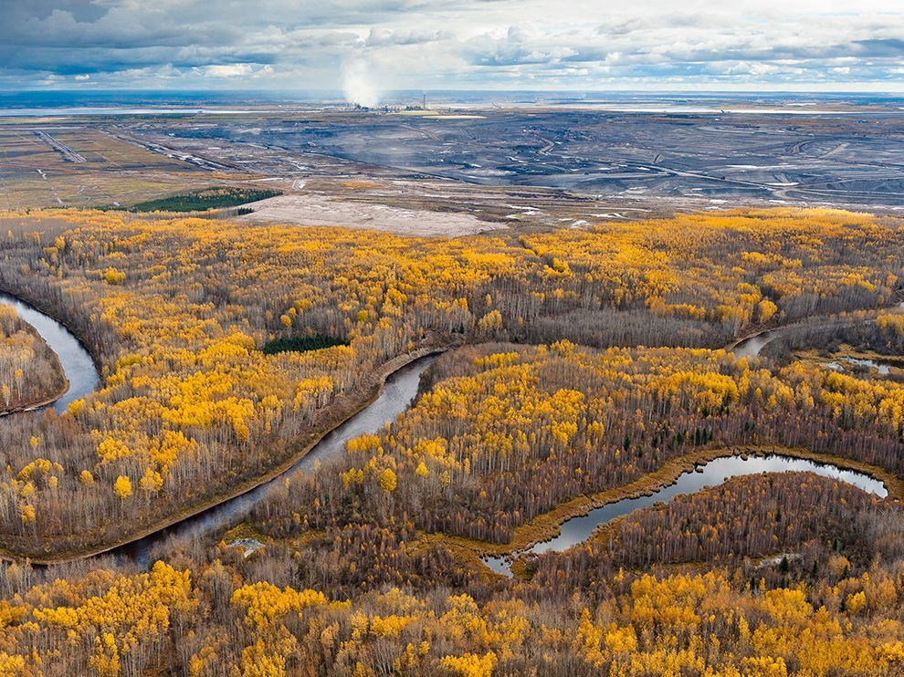 Picture of the MacKay River, a boreal forest, and a tar mine in Alberta, Canada