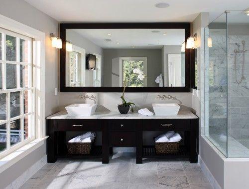 A his & hers bathroom. Framed mirror & vanity sinks. Just needs more lighting.