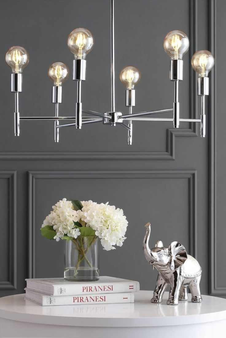 Complete you breakfast nook or foyer with a fun modern touch from this contemporary, chrome-finished pendant light. #JonathanY #HomeDecor #Lamps #DesignerLamps #ModernLighting #CeilingLighting #PendantLighting