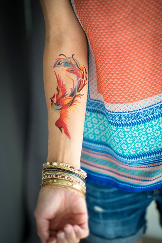 Cute Colorful Phoenix Tattoo On Forearm Phoenix Tattoo Design Phoenix Bird Tattoos Phoenix Tattoo Feminine