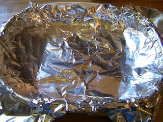 Fill your foil lined baking dish with steaming hot water. Add 2-3 teaspoons Salt & 2-3 teaspoons Baking Soda. and give it a little stir to dissolve the salt.  Add your silver jewelry.  Make sure they touch.  From Stuff Grandma Made blogspot
