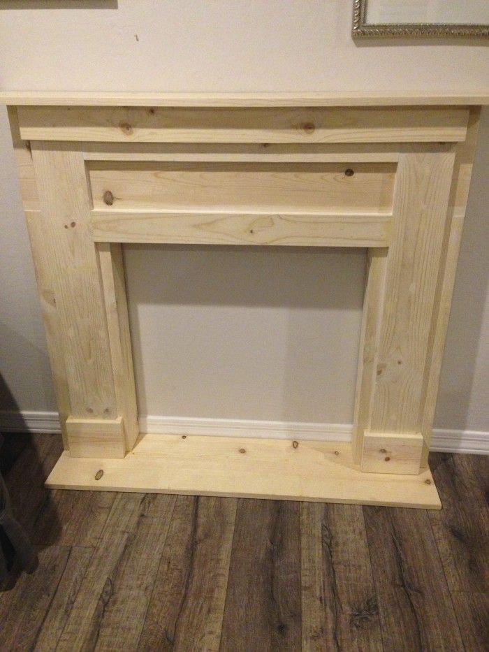 Diy faux fireplace mantel dark faux fireplace and for Dark fireplace mantel
