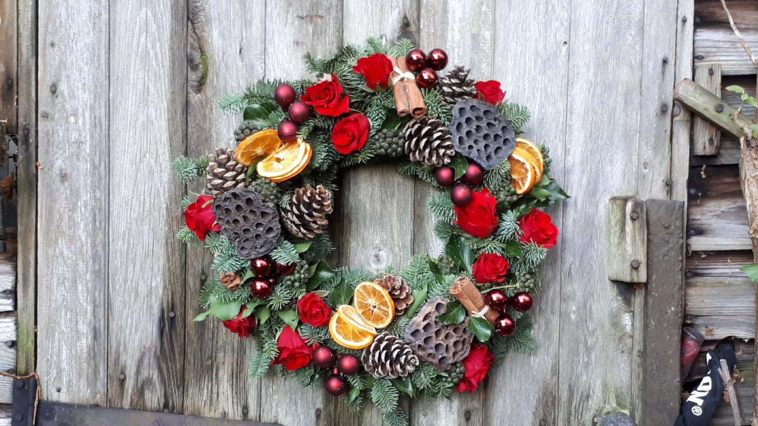 Diy deluxe christmas door wreath on a traditional mossed