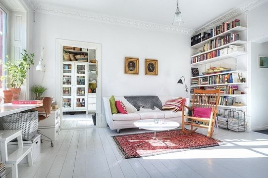 Love the white walls + floor against bright accents