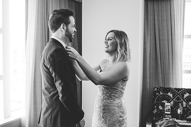 Bride and groom helping each other while getting ready :)