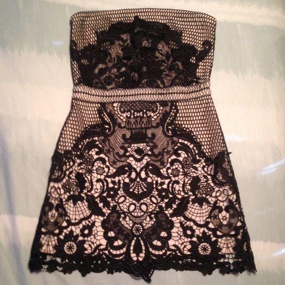 Black/Nude lace strapless mini dress Strapless Black lace mini dress with nude underlining. Size Medium, but fits snug. NWT!! Never worn. Shop Hopes Dresses Mini