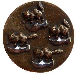 Antique brass button with kitties & cut steel escutcheons.