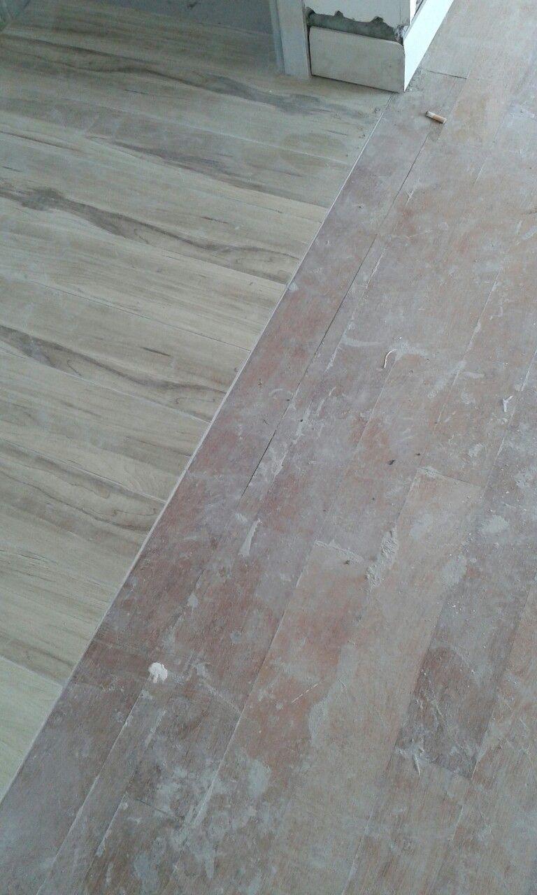 Solid Wood Merbau Floor Next To Tile Floor Before Grind Polish