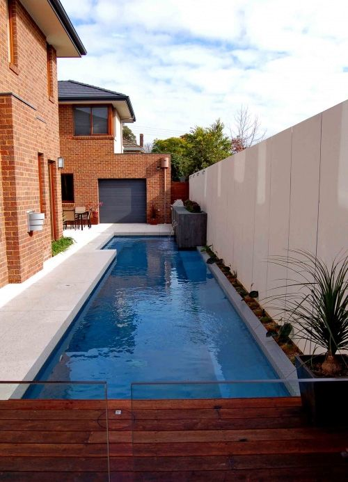 5 modern lap pool design ideas by out from the blue lap for Modern contemporary swimming pools