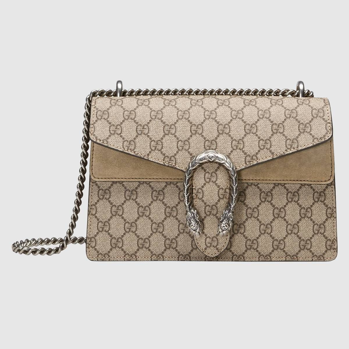 225f6523a36 Shop the Dionysus small GG shoulder bag by Gucci. A structured GG Supreme  canvas bag with our textured tiger head closure-a unique detail referencing  the ...