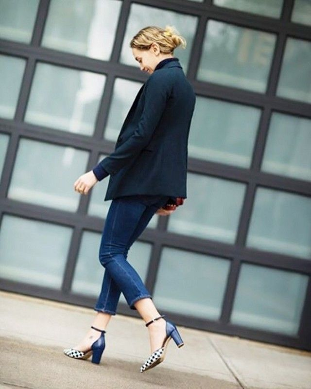 Laurel Pantin, Editorial Director at The Coveteur polishes up her jeans for work by styling them with a blazer and strappy heels