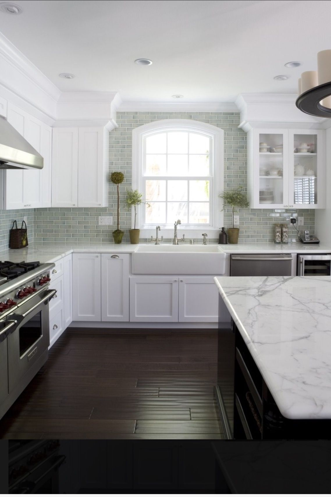 White shaker cabinets hand scraped wood floor crackle subway tile