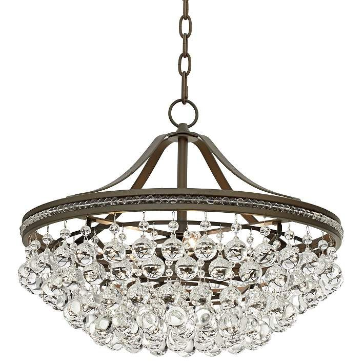 This exquisitely beautiful bronze and clear crystal pendant light is a stylish reimagining of a classic traditional look canopy is 5 wide