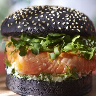 burger black bread, salmon, salad, cheese