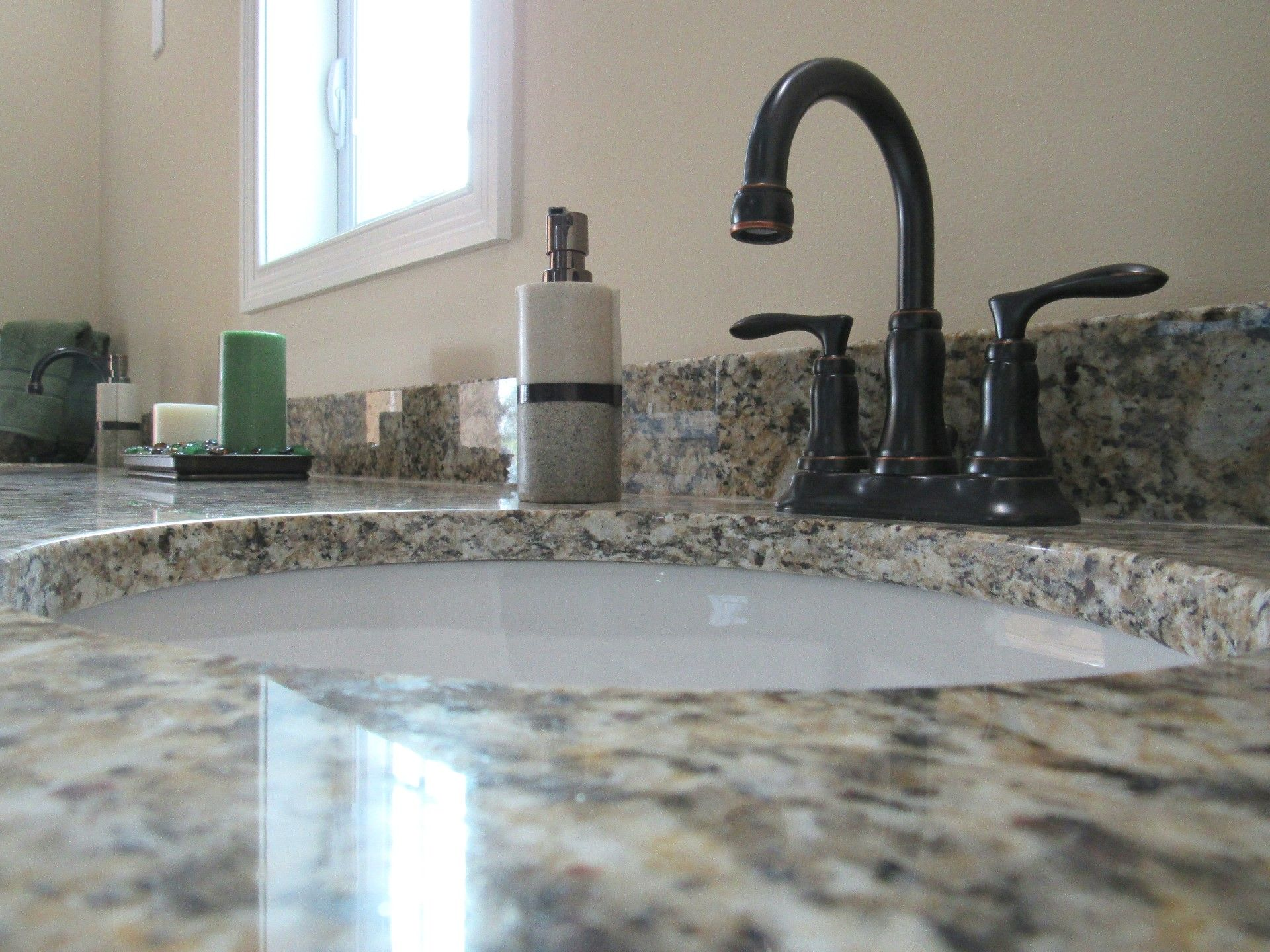 Master Bathroom His And Hers Oil Rubbed Bronze Four Inch Faucet Speckled Tan White And Blac Black Granite Countertops Granite Countertops Black Pearl Granite
