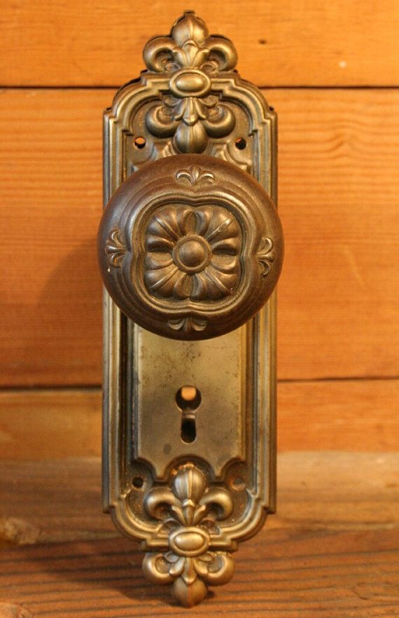 antique cast iron doorknob set with two backplates by old portland