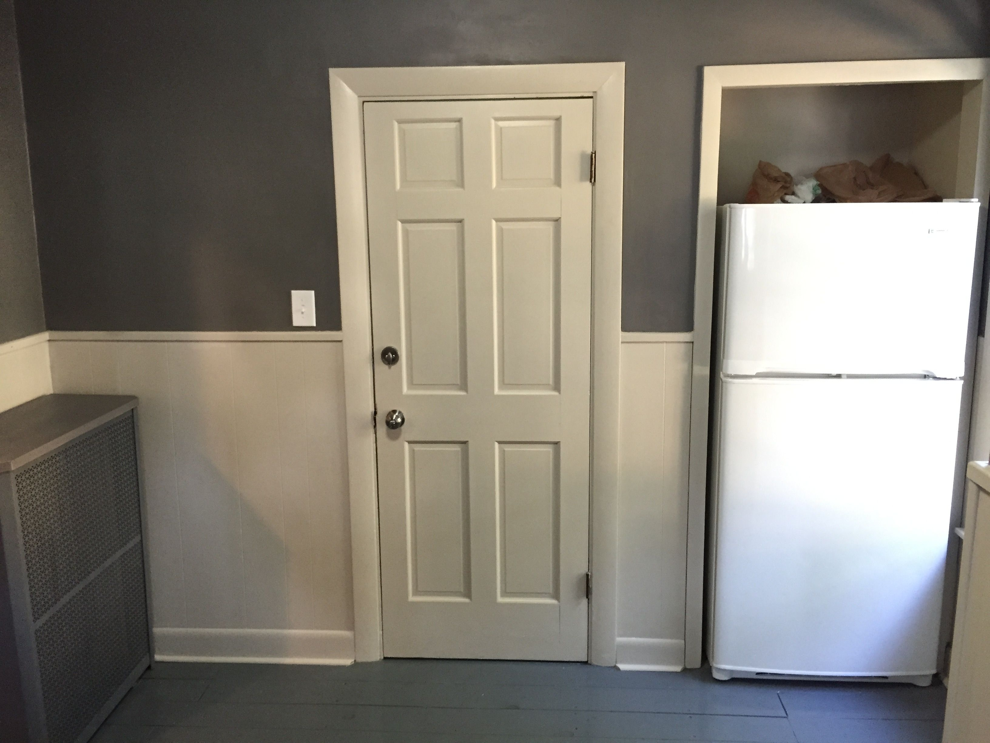 fridge moved into closet to open up room painted wood paneling on