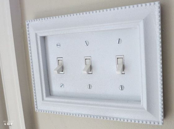 Take old frames and repaint then glue to boring light switches in ...