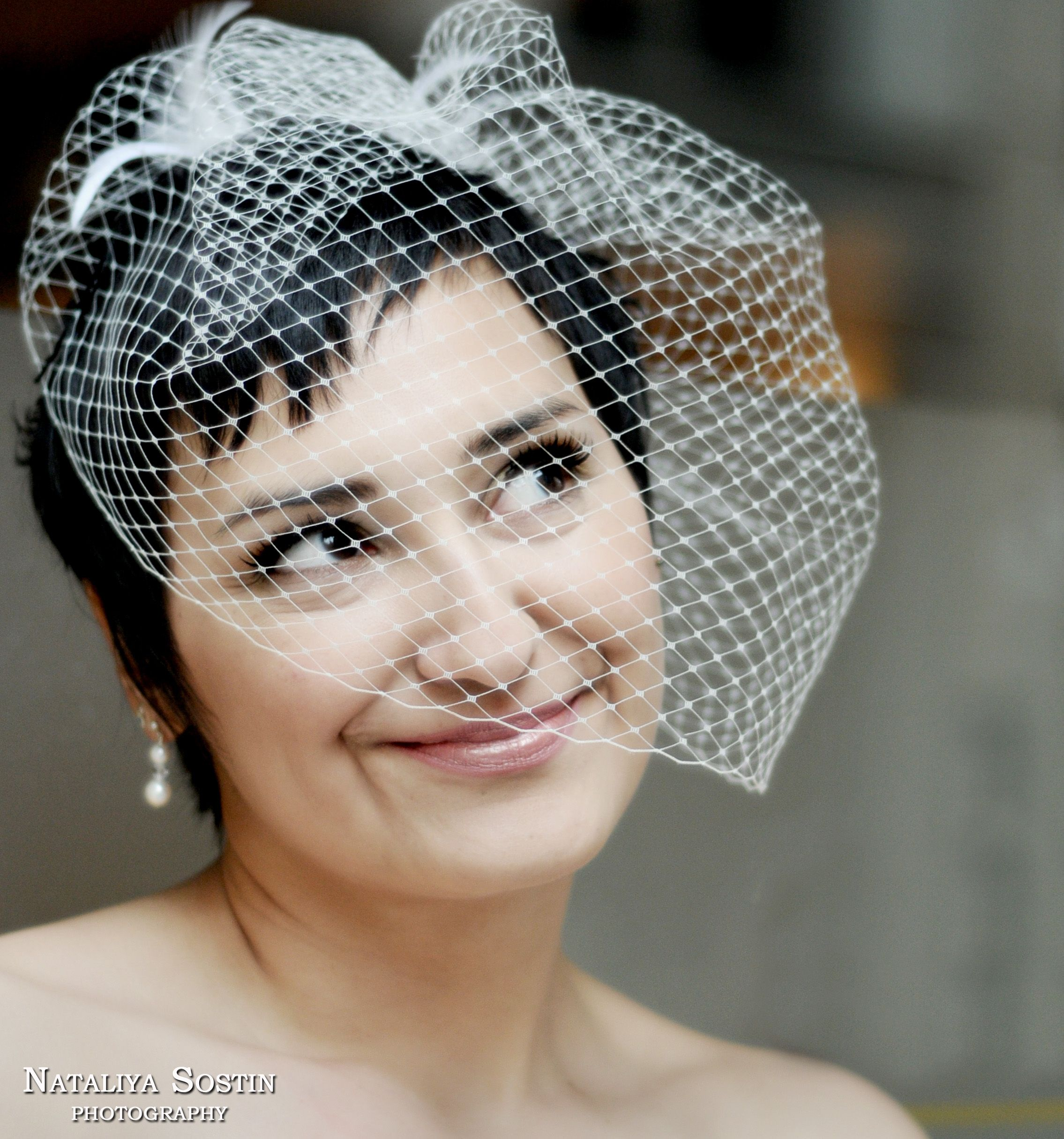 I like the short hair with the birdcage veil!  For me, a bit too much veil, but sucha  pretty look.